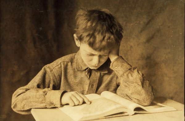 Lewis_Hine,_Boy_studying,_ca._1924