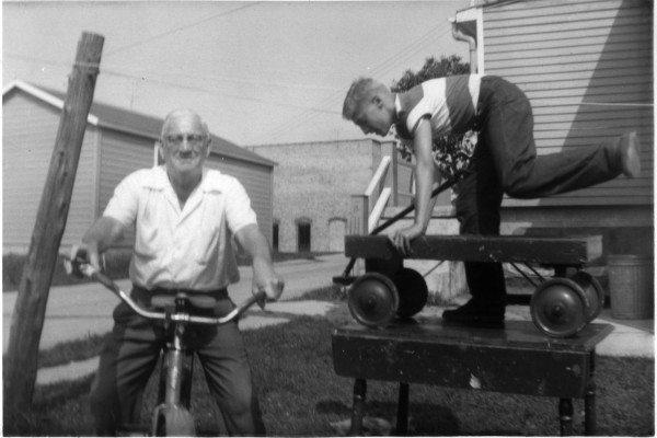 Grandpa-on-bike-kid-on-wagon-on-top-of-table
